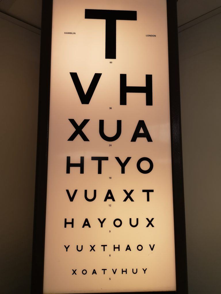 A standard visual acuity measuring chart with letters arranged vertically in decreasing sizes.